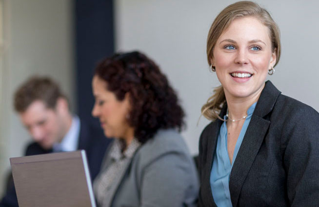 woman with others in a business setting